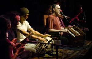 The former Jeffrey Hagel (r.) jams in One Track Heart: The Story of Krishna Das.