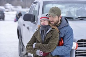 Mireille Enos and Ryan Reynolds enjoy a lighter moment in The Captive.