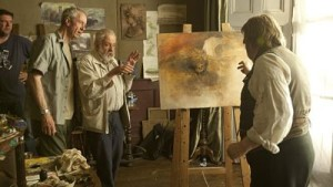 Actor Timothy Spall (r.), director Mike Leigh (ctr.) and cinematographer Dick Pope on the set of Mr. Turner.