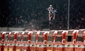 Evel Knievel attempting to jump a row of buses in 1975