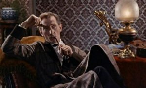 Peter Cushing is Sherlock Holmes in The Hound of the Baskervilles