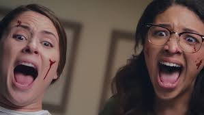 Aliens meets Means Girls in the horror-comedy feature that arrives tomorrow!